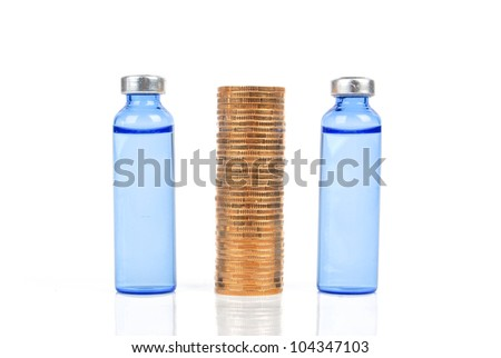 Coin and vial - stock photo