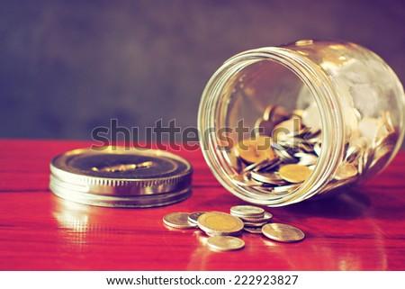 coin in money jar - stock photo