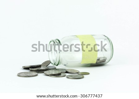 Coin in the glass jar - stock photo