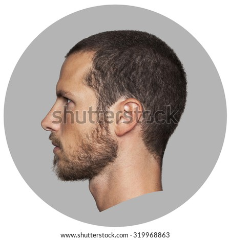 coin like portrait of an handsome young man profile - stock photo