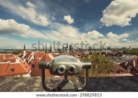 Coin Operated Binocular viewer over European Tourist Place of Tallinn old City Estonia.  - stock photo