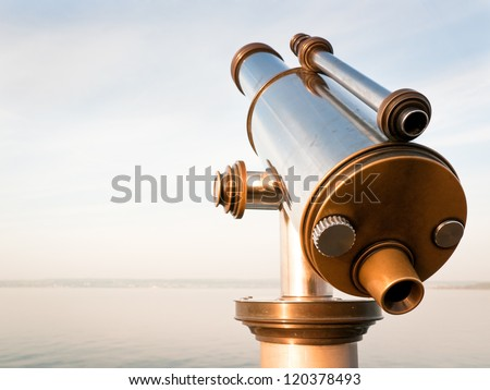 coin-operated binoculars at a lake - stock photo