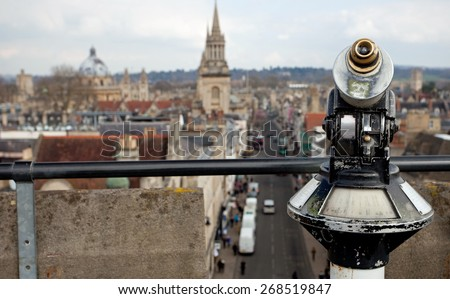 Coin operated binoculars with Oxford in the background - stock photo