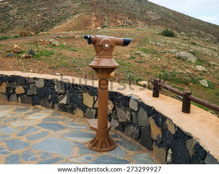 Coin operated binoculars with view over a landscape - stock photo
