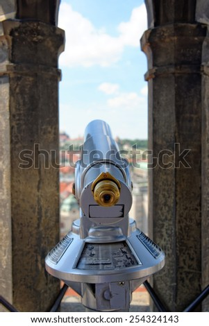 Coin operated spyglass on the City hall tower, Prague, Chech  - stock photo