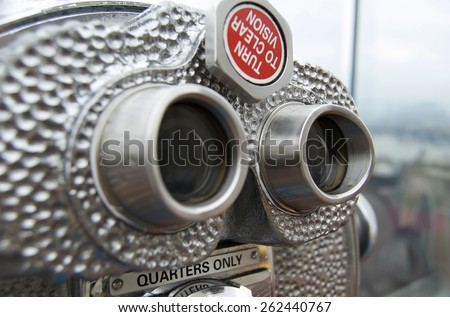 Coin-operated telescope at the Top of the Rock in New York City. - stock photo