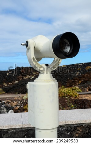 Coin Operated Telescope For Beach Observation, Blue Sky And Clouds - stock photo