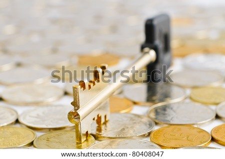 Coins and a key - stock photo