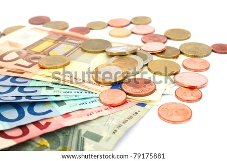 Coins and banknotes isolated on white background. - stock photo