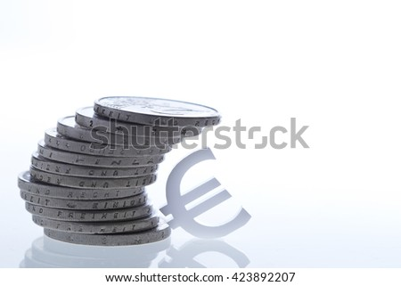 Coins and Euro currency symbol - stock photo