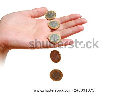 Coins and female hand isolated on white background - stock photo