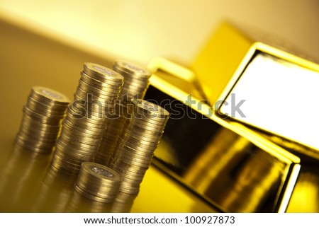 Coins and gold bars, Finance Concept - stock photo