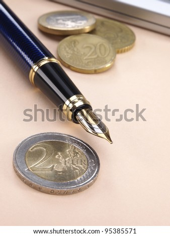 Coins and pen - stock photo
