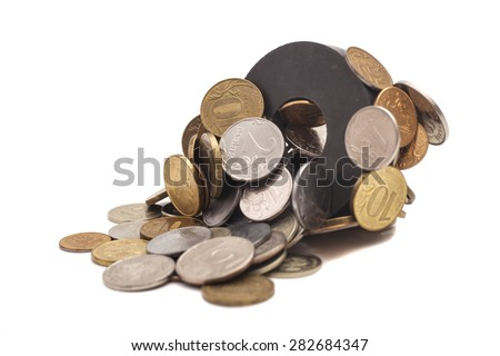 Coins attracted by magnet - stock photo