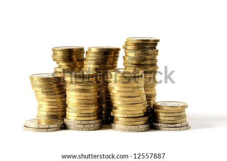 Coins Coin towers on white background - stock photo