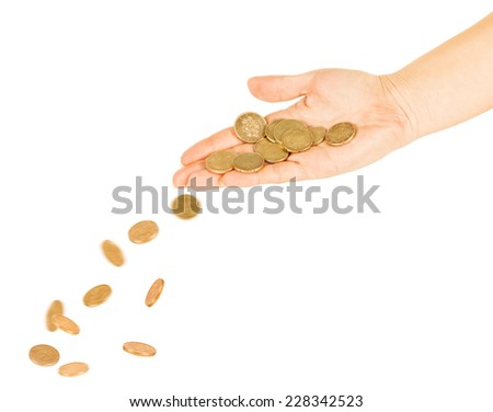 coins fall out of the hands on a pile of gold coins - stock photo