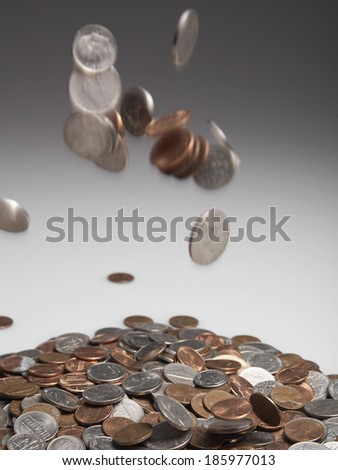 Coins Falling on Pile - stock photo