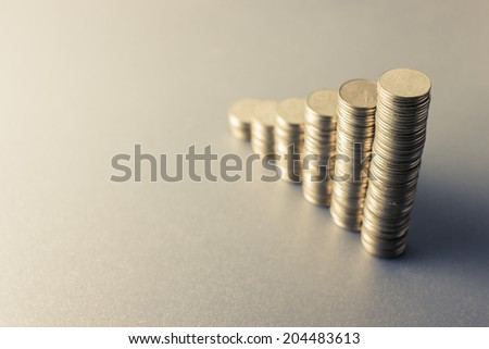 Coins heap stair as growing graph symbol with space for text - stock photo
