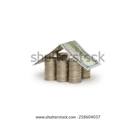 Coins house isolated on white - stock photo
