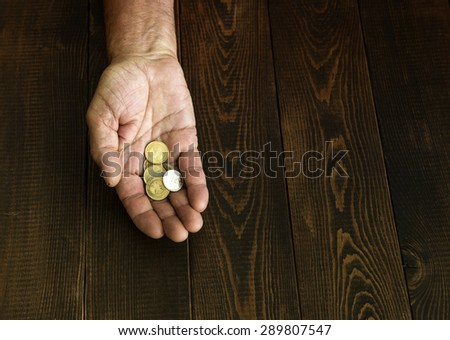 Coins in a man's hand - stock photo