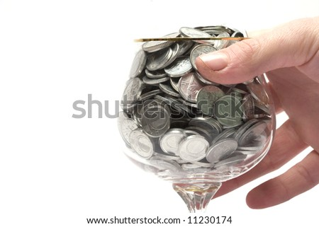 coins in glass - stock photo