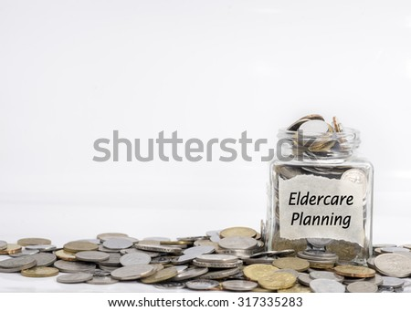coins in jar with eldercare planning label in isolated white background ; financial concept - stock photo