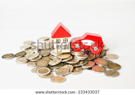 coins in pile and house, car isolated image - stock photo
