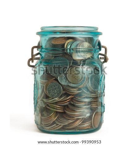 Coins in savings jar isolated on white background - stock photo
