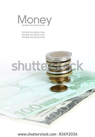 Coins lying on the euro banknote - stock photo