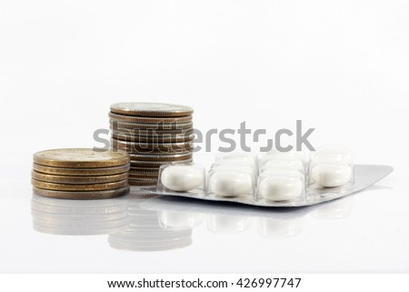 coins, medicines, medicines, rising prices for medicine, the rising cost of drugs, inflation, dollars, isolated - stock photo