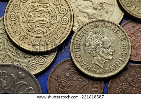 Coins of Denmark. Queen Margrethe II of Denmark and Danish national coat of arms depicted in Danish krone coins. - stock photo