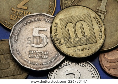 Coins of Israel. Israeli five and ten agorot coins.  - stock photo
