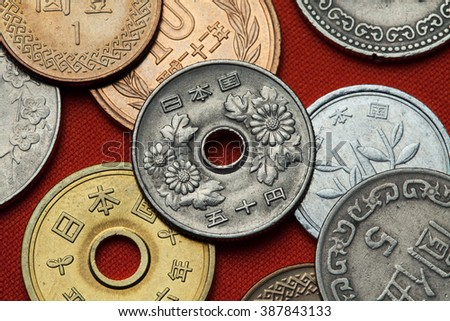 Coins of Japan. Chrysanthemum flowers depicted in the Japanese 50 yen coin. - stock photo