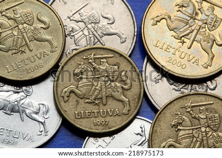 Coins of Lithuania. Lithuanian national coats of arms known as the Vytis depicted in Lithuanian litas coins. - stock photo
