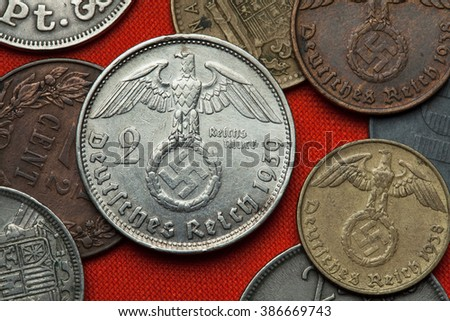 Coins of Nazi Germany. Nazi eagle atop swastika depicted in the German two Reichsmark coin (1939). - stock photo