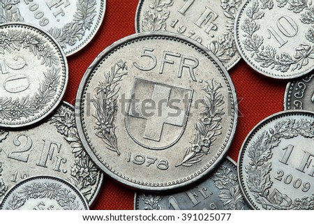 Coins of Switzerland. Coat of arms of Switzerland depicted in the Swiss five franc coin. - stock photo