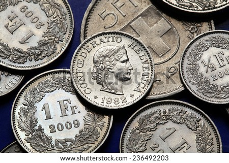 Coins of Switzerland. Libertas head depicted in the Swiss 10 rappen coin. - stock photo