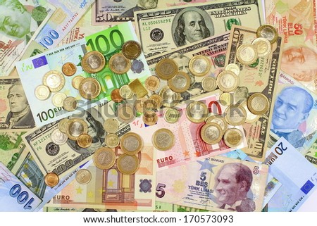 Coins on paper bills as background. Background from dollars and euro bills.  - stock photo