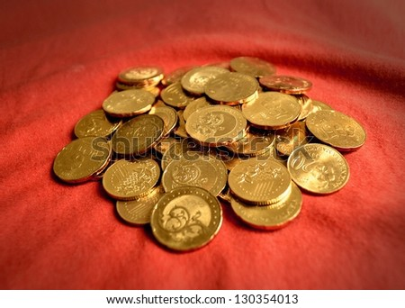 Coins over red - stock photo