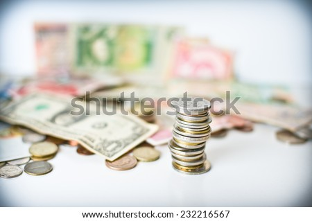 Coins pile with out of focus background and color effects - stock photo