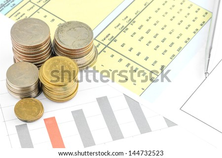 Coins with busniess graph - stock photo