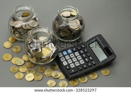 coins with calculator. financial concept - stock photo