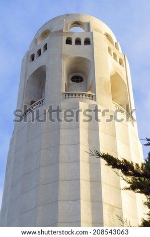 Coit Tower, aka the Lillian Coit Memorial Tower on Telegraph Hill neighborhood of San Francisco, California, United States of America. A close up view of the flutted white tower top. - stock photo