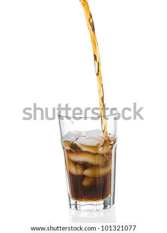 Coke splashing from glass isolated on white background - stock photo