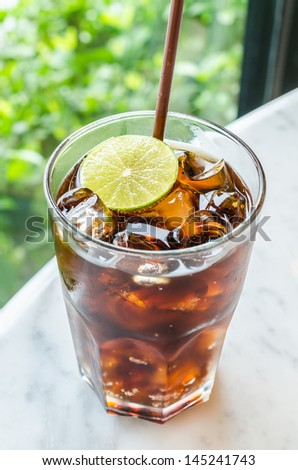 Coke with lemon - stock photo