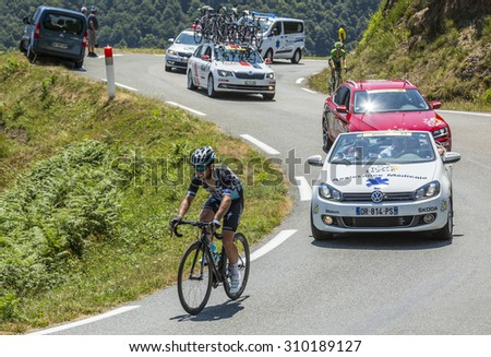 COL D'ASPIN,FRANCE - JUL 15:The Manx cyclist Mark Cavendish of Etixx-Quick Step Team, climbing the road to Col D'Aspin  in Pyrenees Mountains during the stage 11 of Le Tour de France on Juy 15, 2015. - stock photo