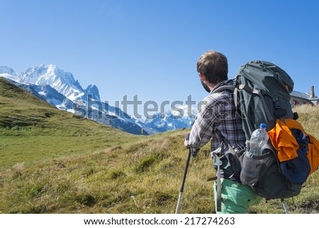 COL DE BALME, FRANCE - SEPTEMBER 01: Backpackers looking at view with Mont Blanc in the background. The area is a stage of the popular Mont Blanc tour. September 01, 2014 in Col de Balme. - stock photo