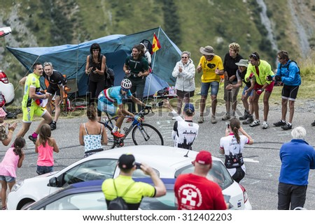 COL DU GLANDON, FRANCE - JUL 24:The Italian cyclist Vincenzo Nibali of AstanaTeam,climbing the road to Col du Glandon in Alps, during the stage 19 of Le Tour de France on July 24, 2015. - stock photo