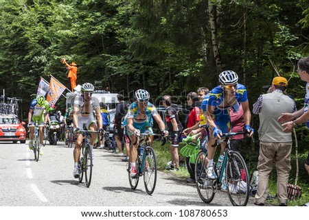 COL DU GRANIER,FRANCE,JUL 13:Alexandr Vinokourov the winner of the gold in the Olympic Men's Road Race in London, climbing mountain pass Granier in the stage 12 of Le Tour de France on July 13 2012 - stock photo