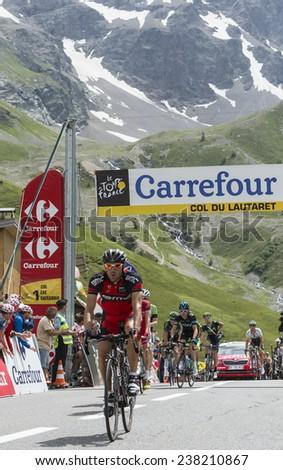 COL DU LAUTARET,FRANCE - JUL 19:The Cyclist Amael Moinard ( BMC Team) arrives on mountain pass Lautaret during the stage 14 of Le Tour de France on July 19 2014. - stock photo